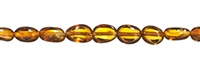 Strings elongate tumbled stones, Amber, cognac medium, app. 04mm