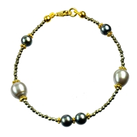 Design bracelet, gold plated silver components, pearls (dyed) and faceted pyrite, length 20cm